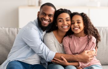 happy Afro-American family of three with perfect smiles