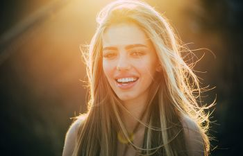 Happy young woman with a perfect smile.