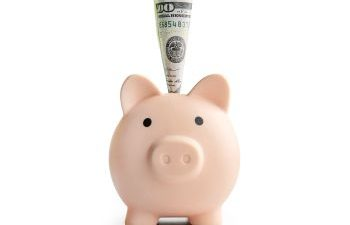 piggy bank with money sticking out