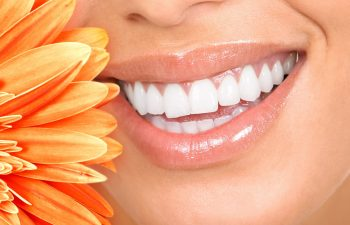 Woman with Bright White Smile next to Flower