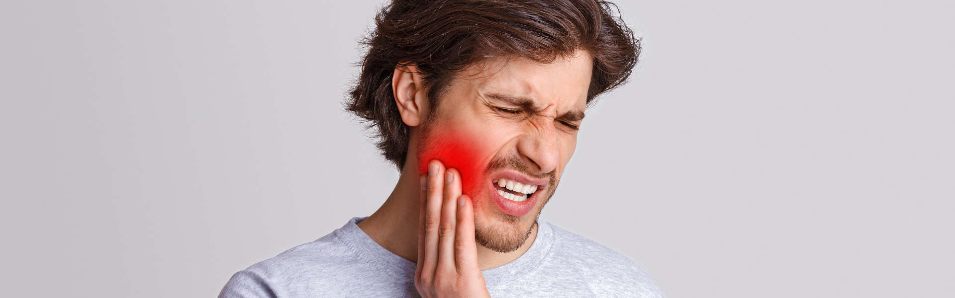 Man suffers from pain in his teeth.